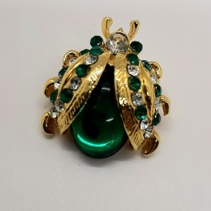 Gold and green crystal beetle pin